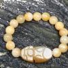 สร้อยข้อมือหยกพร้อมจี้ปี่เซี๊ยะหินโมราสีน้ำผึ้ง ขนาด 10 mm